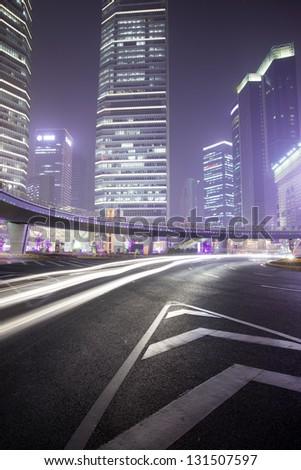 Shanghai at night traffic light traces - stock photo