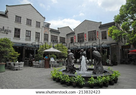SHANGHAI, CHINA-AUGUST 24, 2013: atmosphere and life in Xintiandi, the more famous spot in town. - stock photo