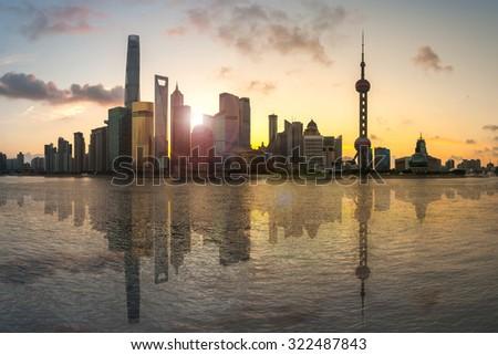 Shanghai, China city skyline on the Huangpu River at sunrise with reflection - stock photo