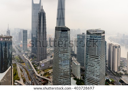 SHANGHAI, CHINA - MAR 31, 2016: View of the Shanghai buildings from the Oriental Pearl Radio and TV Tower. - stock photo