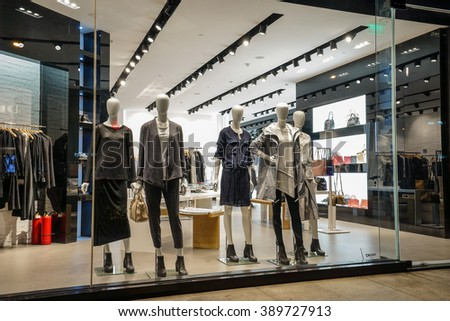 SHANGHAI, CHINA - March 9. 2016: DKNY free standing store in Shanghai. DKNY is a New York-based fashion house specializing in fashion goods for men and women founded in 1984 by Donna Karan. - stock photo