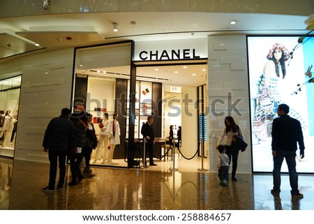 SHANGHAI, CHINA - March 8. 2015: Interior of the IFC Shopping Mall downtown in Pudong Lujiazui. CHANEL inside Just The international women's day at March 8. 2015 Shanghai, China - stock photo