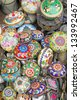 SHANGHAI, CHINA-MAY 4: Dongtai Lu Antique Market colorful  Chinese cups on sale. The market is great for mementos and souvenirs of Shanghai. May 4, 2007 Shanghai, China - stock photo