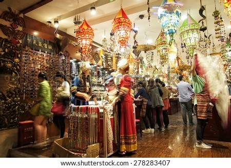 SHANGHAI, CHINA - MAY 2, 2015: Interior of a store with Chinese items at the famous Nanjing Road. It is the main shopping street of Shanghai, China, and is one of the world's busiest shopping streets. - stock photo
