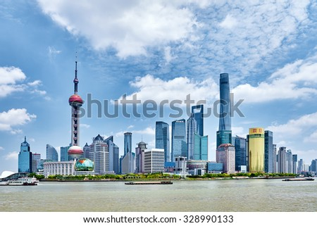 SHANGHAI, CHINA- MAY 24,  2015: Oriental Pearl Tower on  blue sky background. Tower 470 meter the Oriental Pearl is one of Shanghai's tallest buildings. - stock photo