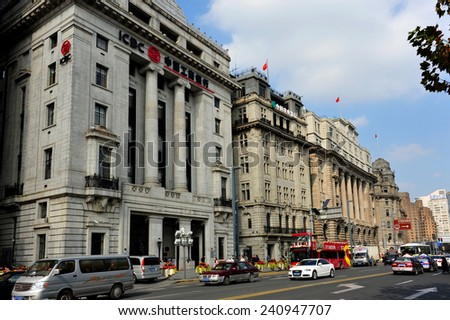 SHANGHAI, CHINA - NOV 20, 2014: The historic buildings of The Bund, a major financial center containing many banks on the Huangpu River, is a famous tourist attraction in Shanghai.  - stock photo