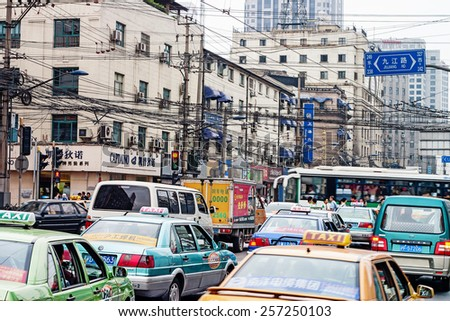 Shanghai, China - October 17, 2006. Cars in the chaotic traffic of Shanghai - stock photo