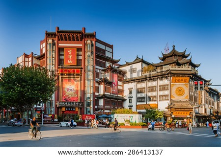 SHANGHAI, CHINA - SEP 16: Chenghuangmiao street with travelers and pagoda style buildings on Sep 16, 2013 in Shanghai. Shanghai is one of China's major cities. - stock photo