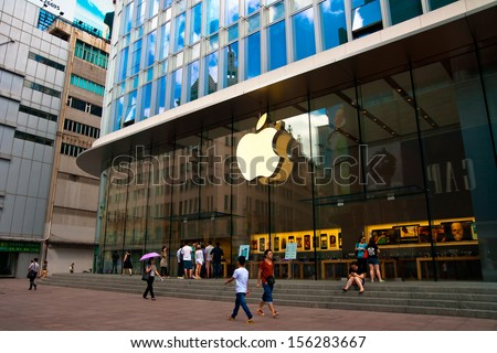 SHANGHAI, CHINA - SEP 17: people walking in front of Apple store on Sep 17, 2013 in Shanghai, This store is one of several stand-alone flagship Apple stores in high-profile locations - stock photo