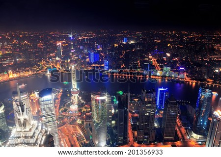 Shanghai city aerial view at night with lights and urban architecture - stock photo