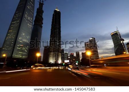 Shanghai city car light trails - stock photo