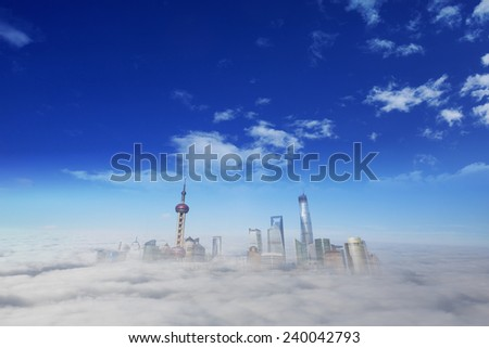 Shanghai city in a foggy day - stock photo