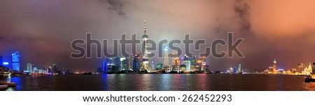 Shanghai city skyline at night over Huangpu river - stock photo