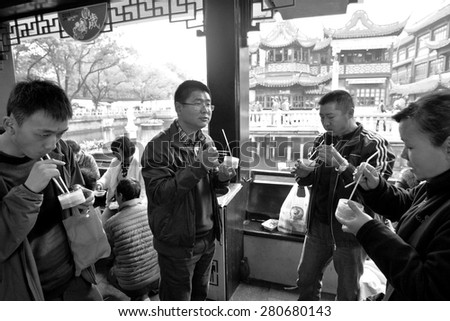 SHANGHAI, CN - MAR 17 2015:Chines people eats Dim sum dumplings food at Yuyuan Tourist Mart in Shanghai, China.Dim sum dumplings it's the most popular and famous food in Shanghai, China - stock photo