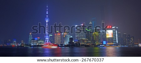 SHANGHAI, CN - MAR 15 2015:Pudong New Area skyline in Shanghai, China at night.It's home to the Lujiazui Finance and Trade Zone, Shanghai Stock Exchange and many of Shanghai's best-known buildings. - stock photo