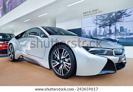 SHANGHAI-DECEMBER. 9, 2014. New BMW i8 sports car. It is an intelligent lightweight constructed plug-in hybrid sports car with an acceleration of 0-100 km/h 4.4 seconds and a top speed of 250 km/h.  - stock photo