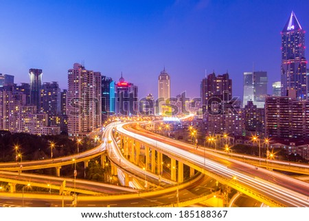 shanghai interchange overpass and elevated road in nightfall - stock photo