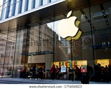 SHANGHAI JANUARY 22: Apple Store at the famous shopping street, Nanjing road in Shanghai, China on Jan 22, 2014. The Apple Retail Store is a chain of retail stores owned and operated by Apple Inc.  - stock photo