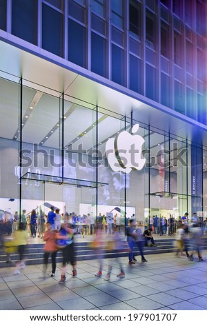 SHANGHAI-JUNE 5, 2014. Apple flag-store in Nanjing East Road at night. According Umeng, China'??s largest analytic firm, 27% of China's smartphones cost over $500, and 80% of those are i Phones. - stock photo