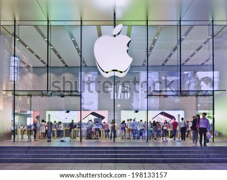 SHANGHAI-JUNE 5, 2014. Apple flag-store in Nanjing East Road at night. According Umeng, China's largest analytic firm, 27% of China's smartphones cost over $500, and 80% of those are i Phones. - stock photo