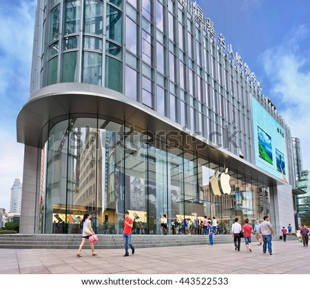 SHANGHAI-JUNE 6. Apple flagship Store. If a Shanghai young man cannot afford a car or an apartment, the next best is an iPhone, but better an iPad. The Apple cult still reigns supreme in China.  - stock photo