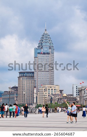 SHANGHAI-JUNE 6, 2014. Bund Boulevard with art-deco architecture. Ornate Western buildings are a legacy of Shanghai's colonial past, it was carved into zones under foreign influence in 19th century. - stock photo