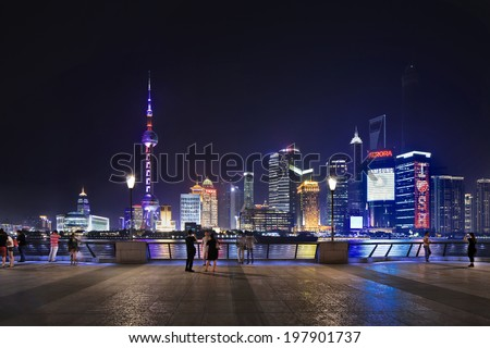 SHANGHAI�JUNE 5, 2014. Huangpu River and Pudong, Lujiazui district at night. The Pudong district houses Lujiazui Finance and Trade Zone and the Shanghai Stock Exchange, it is China's financial center. - stock photo