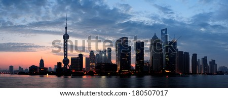 Shanghai morning silhouette before sunrise with city skyline and colorful sky over Huangpu River - stock photo