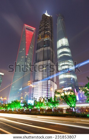 Shanghai - October 5: shanghai lujiazui finance and trade zone skyscraper at night on October 5, 2014 in Shanghai, China.Shanghai is an international metropolis.  - stock photo