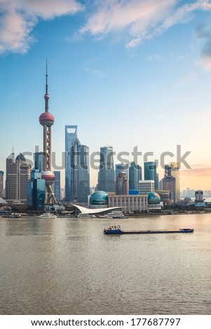 shanghai pudong at dusk,modern building skyline with river  - stock photo