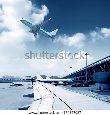 Shanghai Pudong International Airport, a busy runway. - stock photo