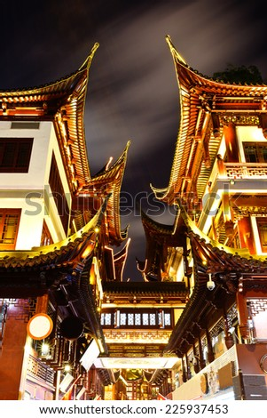 shanghai's famous traditional architecture of yuyuan garden at night - stock photo