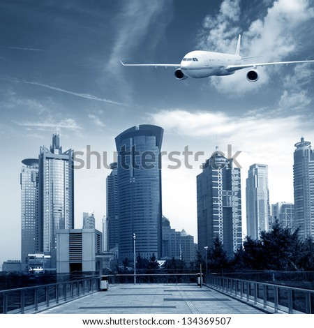 Shanghai's skyscrapers and airplanes on sky - stock photo