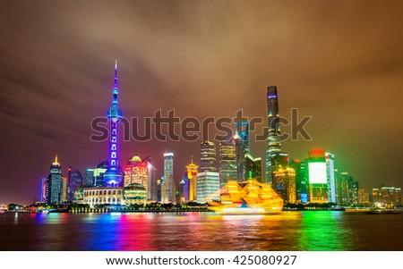 Shanghai skyline above the Huangpu River at night, China - stock photo