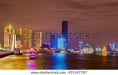 Shanghai skyline above the Huangpu River at night, China - stock photo