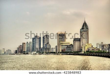 Shanghai skyline above the Huangpu River in China - stock photo