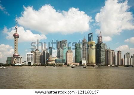 shanghai skyline against a blue sky - stock photo