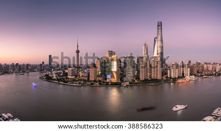 Shanghai skyline and Huangpu river at sunset - stock photo