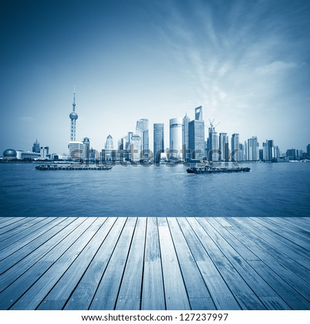 shanghai skyline and wooden floor with blue tone,beautiful scenery of the huangpu river. - stock photo