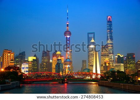 Shanghai skyline at dusk with illuminated Waibaidu bridge, China - stock photo