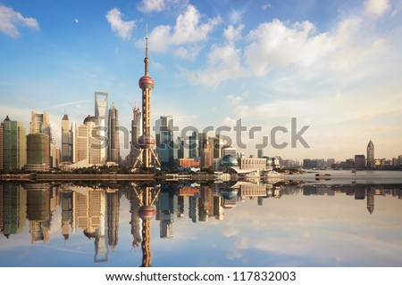 shanghai skyline at dusk with reflection,China - stock photo