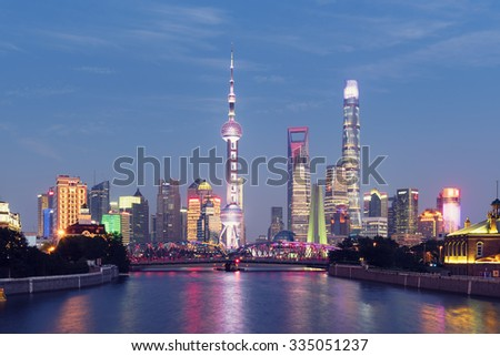 Shanghai skyline at night. Oriental Pearl Tower, Shanghai World Financial Centre,Jin Mao Tower and Shanghai Tower are visible. - stock photo