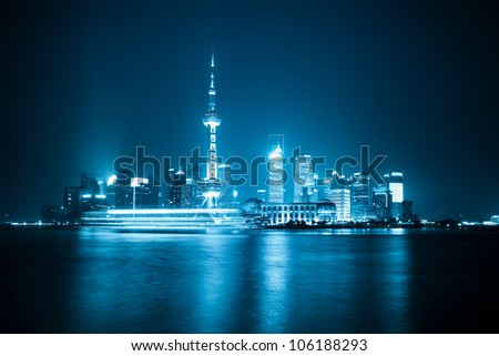 shanghai skyline at night with blue tone - stock photo