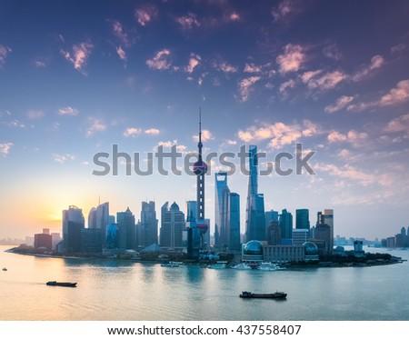 shanghai skyline in sunrise , the rosy colour of dawn spreads all over the sky. - stock photo
