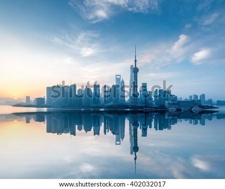 shanghai skyline with reflection in sunrise , China - stock photo