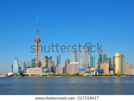 Shanghai skyline with skyscrapers and blue clear sky over Huangpu River. - stock photo