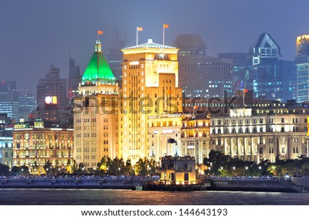 Shanghai urban architecture over river at dusk - stock photo