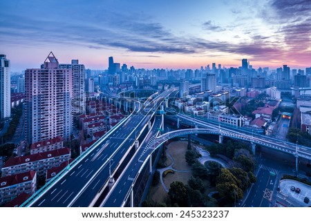 Shanghai, yanan west road intersection at dusk, modern city skyline and transport - stock photo