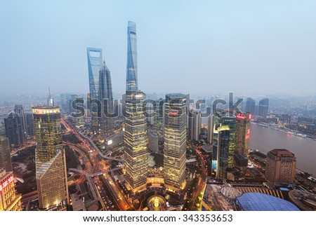 Shanghail, China - Oct 12, 2015: Elevated view of  Lujiazui district in Shanghai. Lujiazui has been developed specifically as a new financial district of Shanghai.  - stock photo