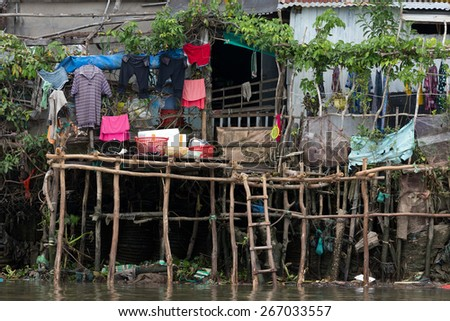 Shanti poor wooden Vietnamese home along the Mekong river in Can Tho city, Vietnam - stock photo